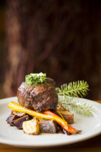 Filet over carrots and potato with Douglas Fir Garnish